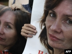 Activists hold portraits of Natalya Estemirova during a rally in Moscow in 2010.