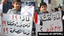 اعتصام امام كنيسة سيدة النجاة ببغداد_ الارشيف
