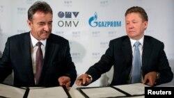 Керівники австрійською OMV Ґерхард Ройс (л) і російського «Газпрому» Олексій Міллер