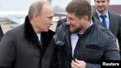 Vladimir Putin pictured with Ramzan Kadyrov in 2011.