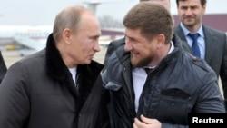 Vladimir Putin with Chechen leader Ramzan Kadyrov (right) in 2011.