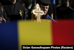 "A Romanian nun takes part in a rally in support of a ""yes"" vote in the referendum in Draganesti on October 4."