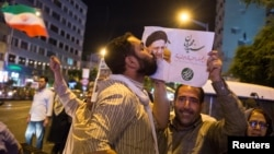A supporter of Ebrahim Raisi kisses his poster during a presidential campaign rally in Tehran in 2017. The conservative cleric lost his bid for the presidency the last time around, but is seen as a front-runner in this year's vote.