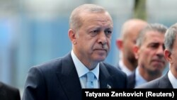 Turkish President Tayyip Erdogan arrives for the second day of a NATO summit in Brussels, Belgium, July 12, 2018