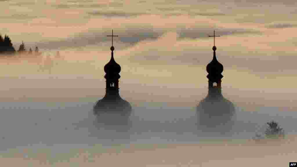 Church spires shrouded in fog at St. Peter's Abbey in the Black Forest, Germany, on December 27. (AFP/Rolf Haid)