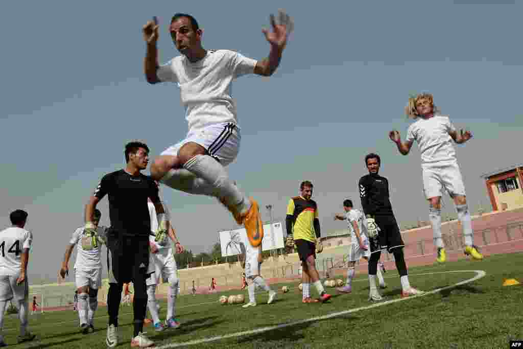 Afghan footballers participate in a training session at the Kabul stadium on September 2.