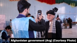 Incumbent Ashraf Ghani casts his vote in a voting center in Kabul.