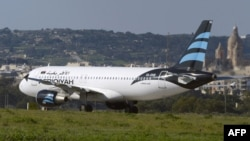 The hijacked Airbus A320 operated by Afriqiyah Airways after it landed at Luqa Airport in Valletta on December 23.
