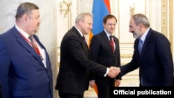 Armenia - Prime Minister Nikol Pashinian greets Russian Culture Minister Vladimir Medinsky (second from right) and other Russian officials visiting Yerevan, 29 June 2018.