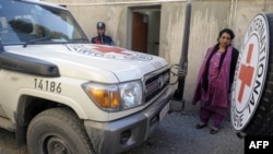 A Pakistani employee of the International Committee of the Red Cross (ICRC) stands next to the vehicle of British employee Khalil Ahmad Dale in Quetta in January, when Dale was abducted.