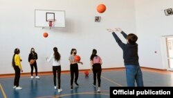 Armenia - Children play basketball at a school in the town of Gavar, March 9, 2021.