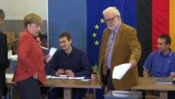 Merkel i Šulc na biralištima