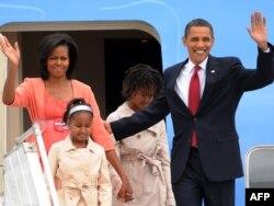 Porodica Obama na okupu