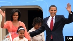 U.S. President Barack Obama, wife Michelle, and daughters Sasha and Malia arriving in Moscow on July 6.