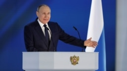 Russian President Vladimir Putin delivers his annual address to the Federal Assembly in Moscow on April 21, 2021.