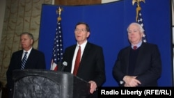 Republican U.S. Senators John McCain, John Barrasso, and Lindsey Graham at a press conference in Kabul after meeting with Afghan President Karzai