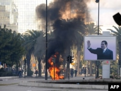 Tunisia -- Smoke rises from fire left after clashes between security forces and demonstrators in Tunis, 14Jan2011