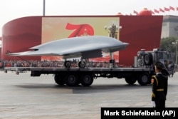A Chinese military truck carrying a stealth attack drone during a military parade in Beijing in October 2019.