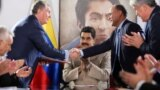The head of the Russian state oil firm Rosneft, Igor Sechin, (left) shakes hands with the Venezuelan oil minister and the president of the South American country's state oil company PDVSA, Manuel Quevedo, in front of Venezuelan President Nicolas Maduro in Maiquetia in December 2017.