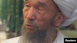 Ид Хақ мешітінің бас имамы болған Жұма Тахир. 3 тамыз 2011 жыл.