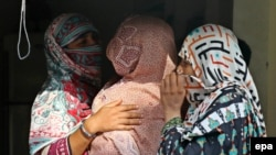 Mothers whose children were sexually abused by a gang gather at a house in the village of Hussain Khanwala in the Kasur district of Punjab province.