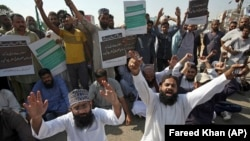 Supporters of a Pakistani religious group chant slogans while blocking a highway in the southern Pakistani city of Karachi on October 31.