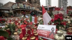 Candles, flowers, and condolence notes are placed on Breitscheidplatz square in remembrance of the victims of the December 19 terrorist attack in Berlin.