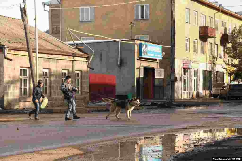 The dog, it appears, is walking the boy in this image from the town of Akhalkalaki. Photo by Nino Odzelashvili.