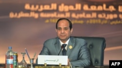 Egypt -- Egyptian President Abdel Fattah al-Sisi looks on during the Arab League summit at the Red Sea resort of Sharm El-Sheikh, March 29, 2015