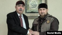 Afghan First Vice President Abdul Rashid Dostum (left) meets with Chechnya's Ramzan Kadyrov in Grozny on October 5.