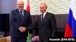 Belarusian leader Alyaksandr Lukashenka (left) meets with Russian President Vladimir Putin in the Black Sea resort of Sochi in September 2020.