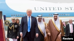 Saudi Arabia's King Salman bin Abdulaziz Al Saud welcome U.S. President Donald Trump during a reception ceremony in Riyadh.