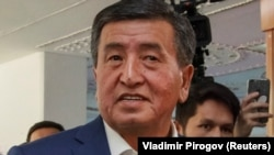Sooronbai Jeenbekov outside a polling station in Bishkek on October 15