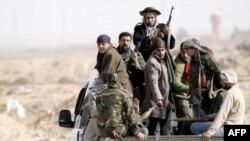 Qaddafinin hakimiyyətinə son qoyulmasını tələb edən silahlı vətəndaşlar, 2 mart 2011