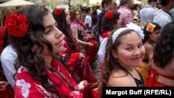 Girls walk in the parade of the Khamoro World Roma Festival in Prague on May 29, 2015.