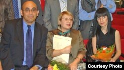 Arif (left to right), Leyla, and Dinara Yunus attend a human rights award ceremony. (undated)