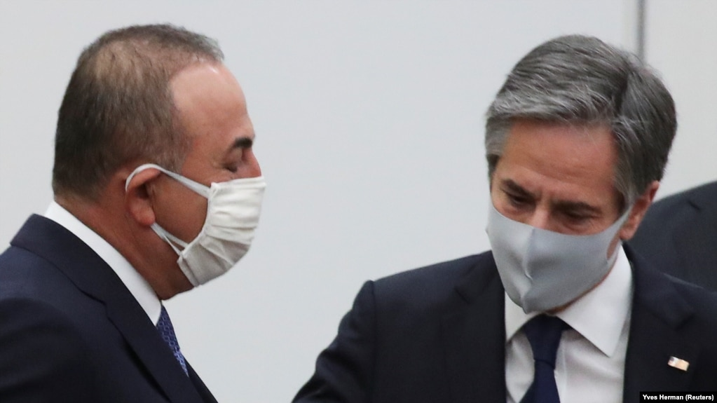 Turkish Foreign Minister Mevlut Cavusoglu (left) and U.S. Secretary of State Antony Blinken arrive at NATO headquarters in Brussels on March 23.