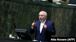 Iranian Foreign Minister Mohammad Javad Zarif delivers a speech over a bill to counter terrorist financing to parliament in Tehran, October 7, 2018