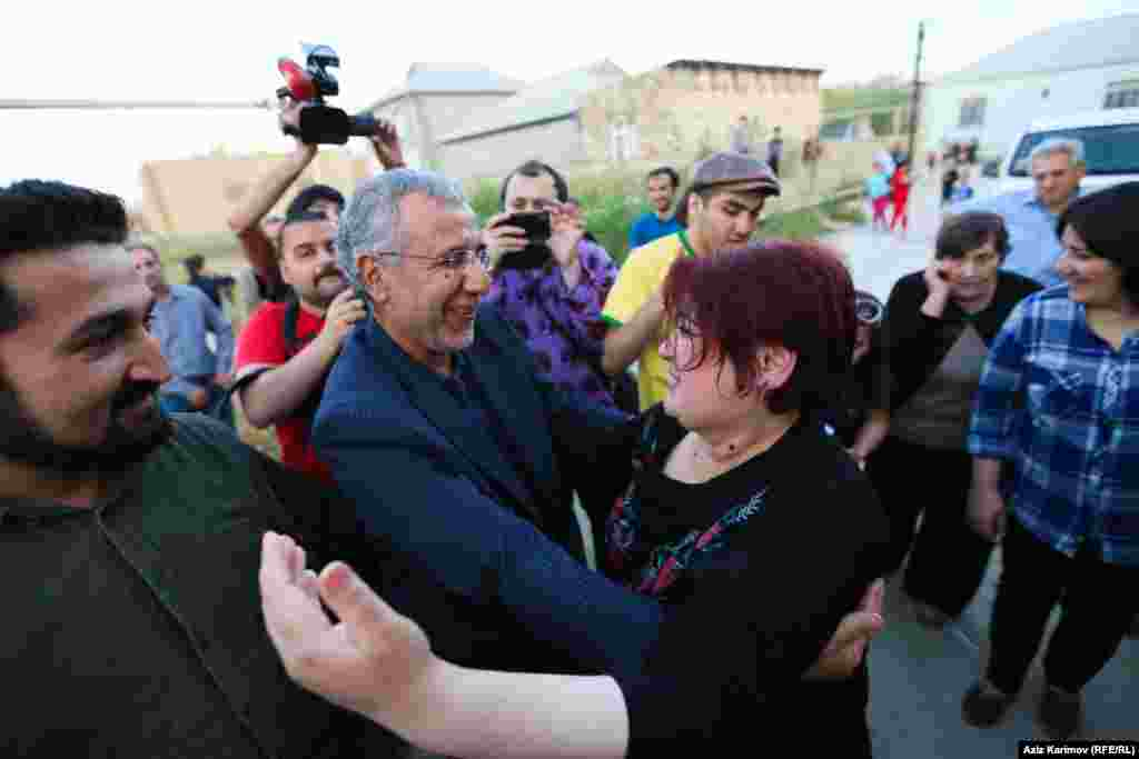 Ismayilova is greeted by Intigam Aliyev, a human rights lawyer released from prison on March 28 after his 7 1/2-year sentence was commuted.