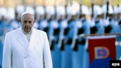 Pope Francis reviews a honor guard during a welcoming ceremony at the presidential palace in Ankara, Turkey.