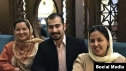 Three Iranian Baha'is, sentenced to prison.