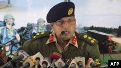 Bangladeshi Army spokesman Brigadier General Muhammad Masud Razzaq briefs reporters on January 19 on what was described as a failed coup attempt.