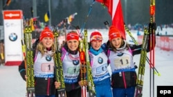 Germany - Eva Puskarcikova (L-R), Gabrela Soukalova, Vitkova Veronika and Jitka Landova of Czech Republic cheer after winning the 4x6 km women's relay race during the Biathlon World Cup at the Chiemgau Arena in Ruhpolding, Germany, 14 January 2015