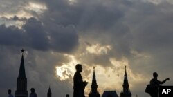 The sun sets on Red Square near the Kremlin.