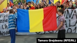 "Protesters rally in Chisinau in favor of Moldova becoming part of Romania. Kaplan says the notion of the two countries unifying is a longstanding idea that is ""never really off the table."""