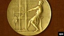 Пулитцеровская золотая медаль