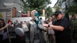WATCH: Ukrainian Activist Attacked With Green Chemical Liquid, Cream Pies
