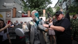 Ukrainian Activist Attacked With Green Chemical Liquid, Cream Pies