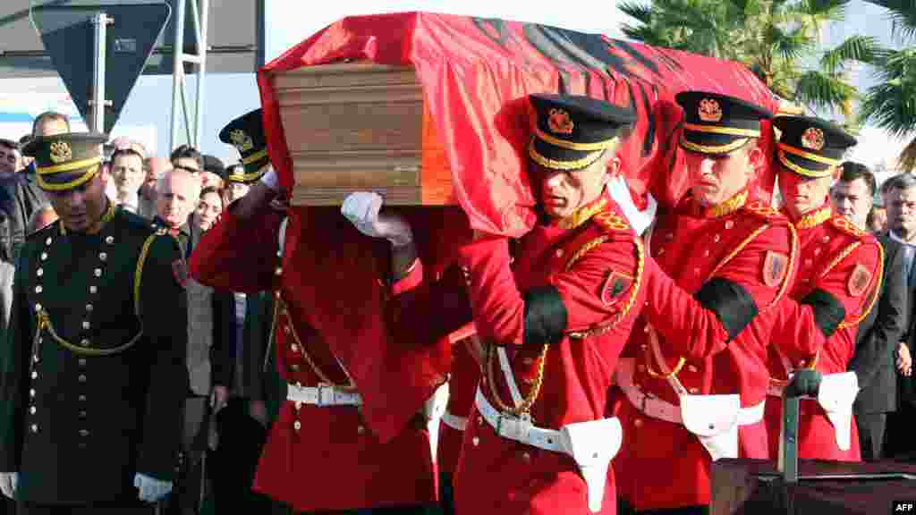 Albanian honor guards carry a coffin with the remains of Albania's self-proclaimed king, Zog I, after arriving back in his home country from France, where he died in exile in 1961. Zog's remains are due to be buried in a newly built mausoleum for the royal family in an official ceremony on November 17. (AFP)