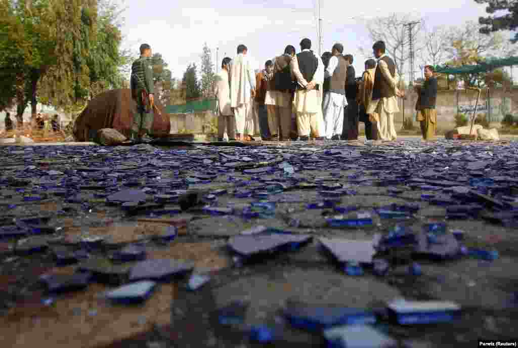 Afghans gather at the site of a suicide attack in Jalalabad. (Reuters/Parwiz)